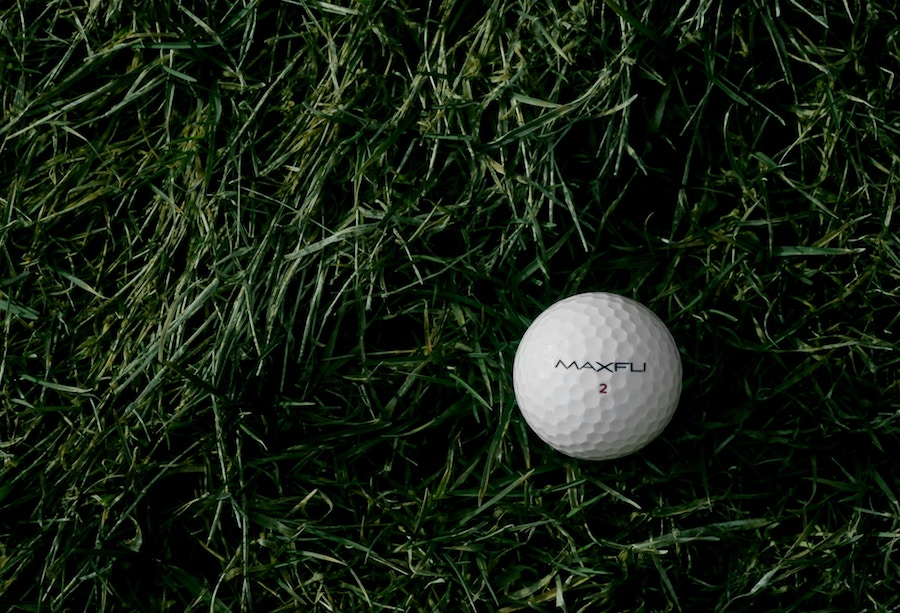 A close up of a golf ball on grass