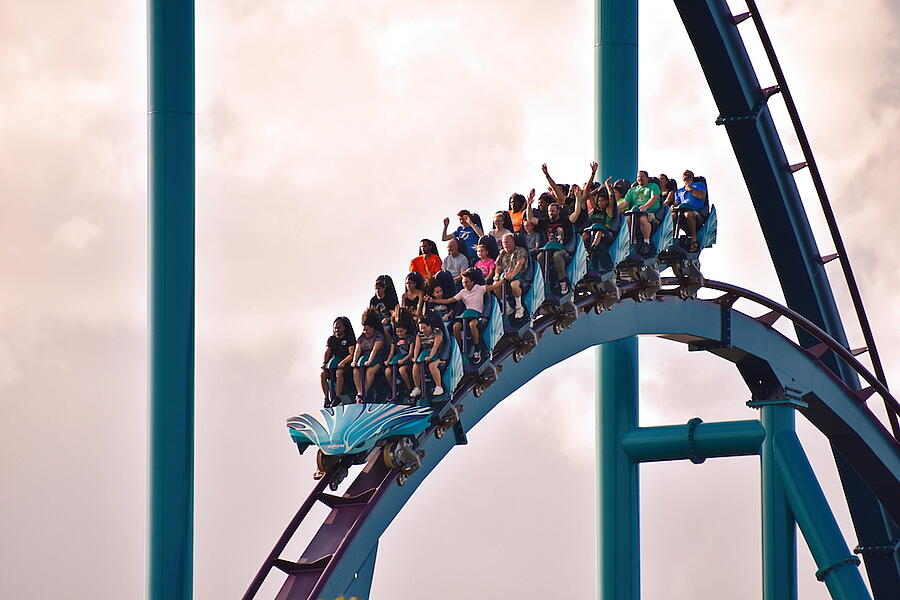 People are on a blue rollercoaster