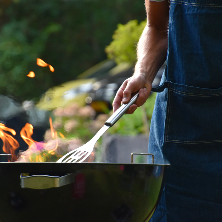 A man is grilling