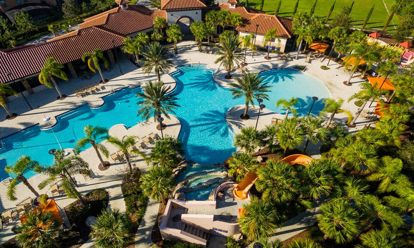 Big pool surrounded by palm trees at Solterra Resort
