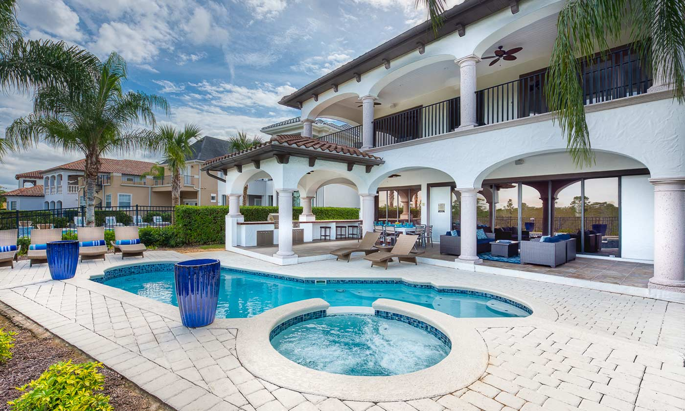 Jeeves Florida Rentals -Luxury home view from pool and hot tub