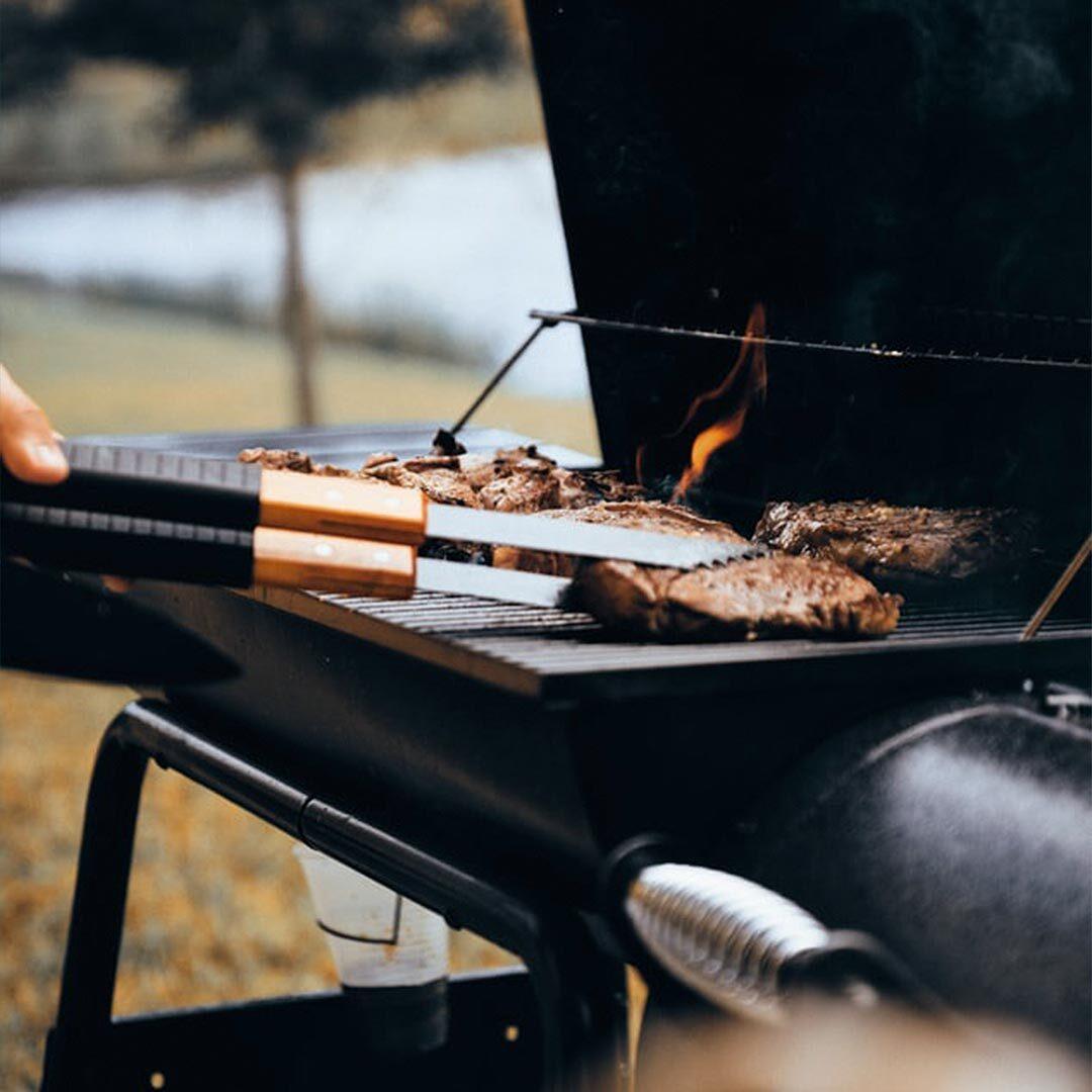 burgers grilling on a burner BBQ