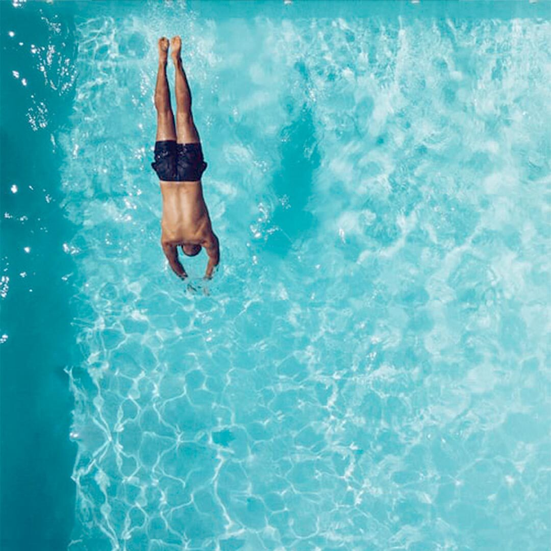 man diving into a pool
