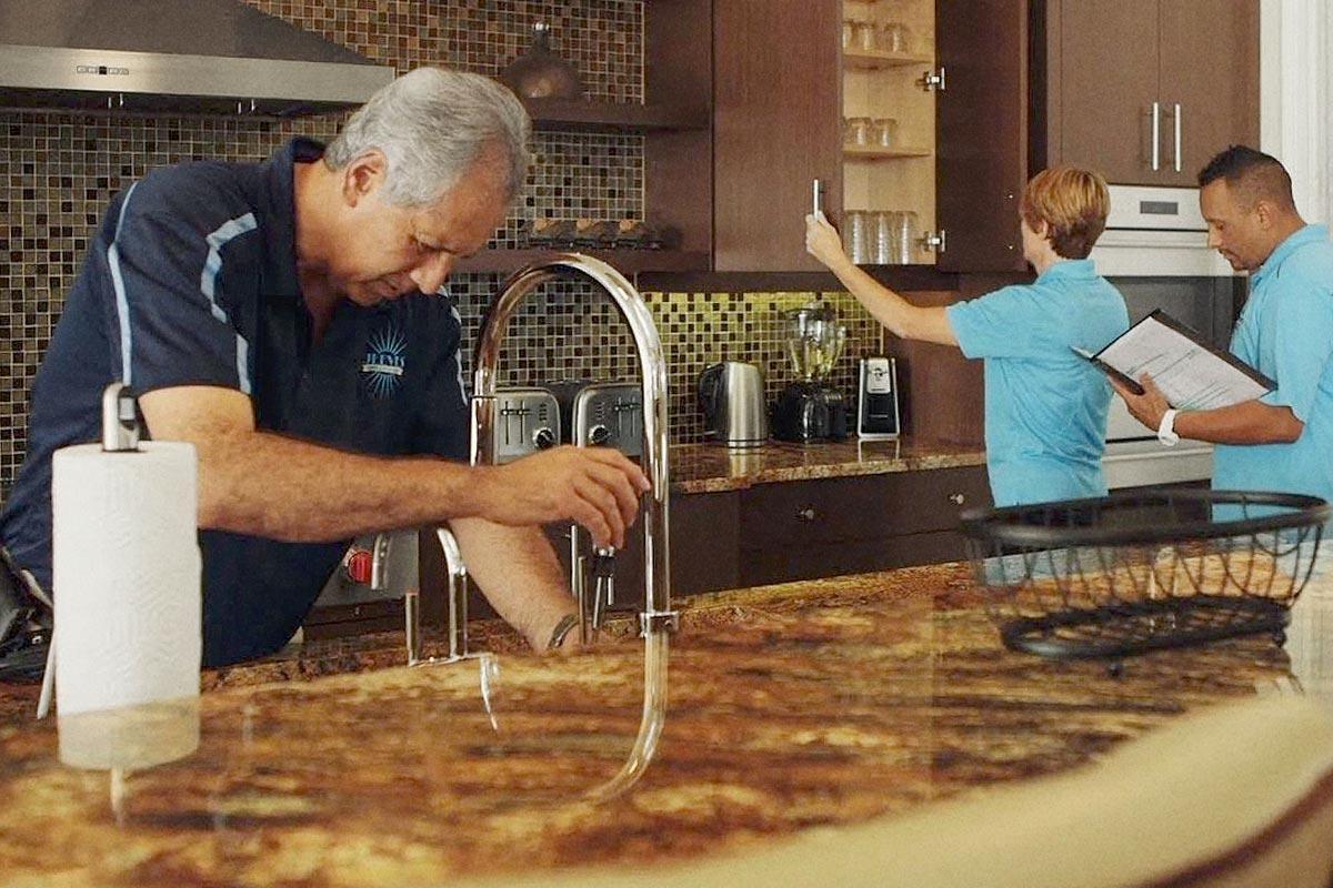 Staff cleaning kitchen